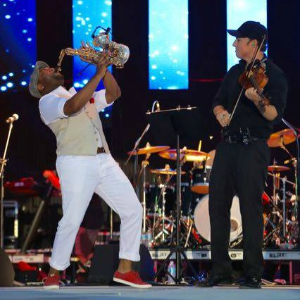 Saxophonist and violinist on stage at the Seabreeze Jazz Festival in Panama City Beach