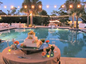 watercolor night reception at pool