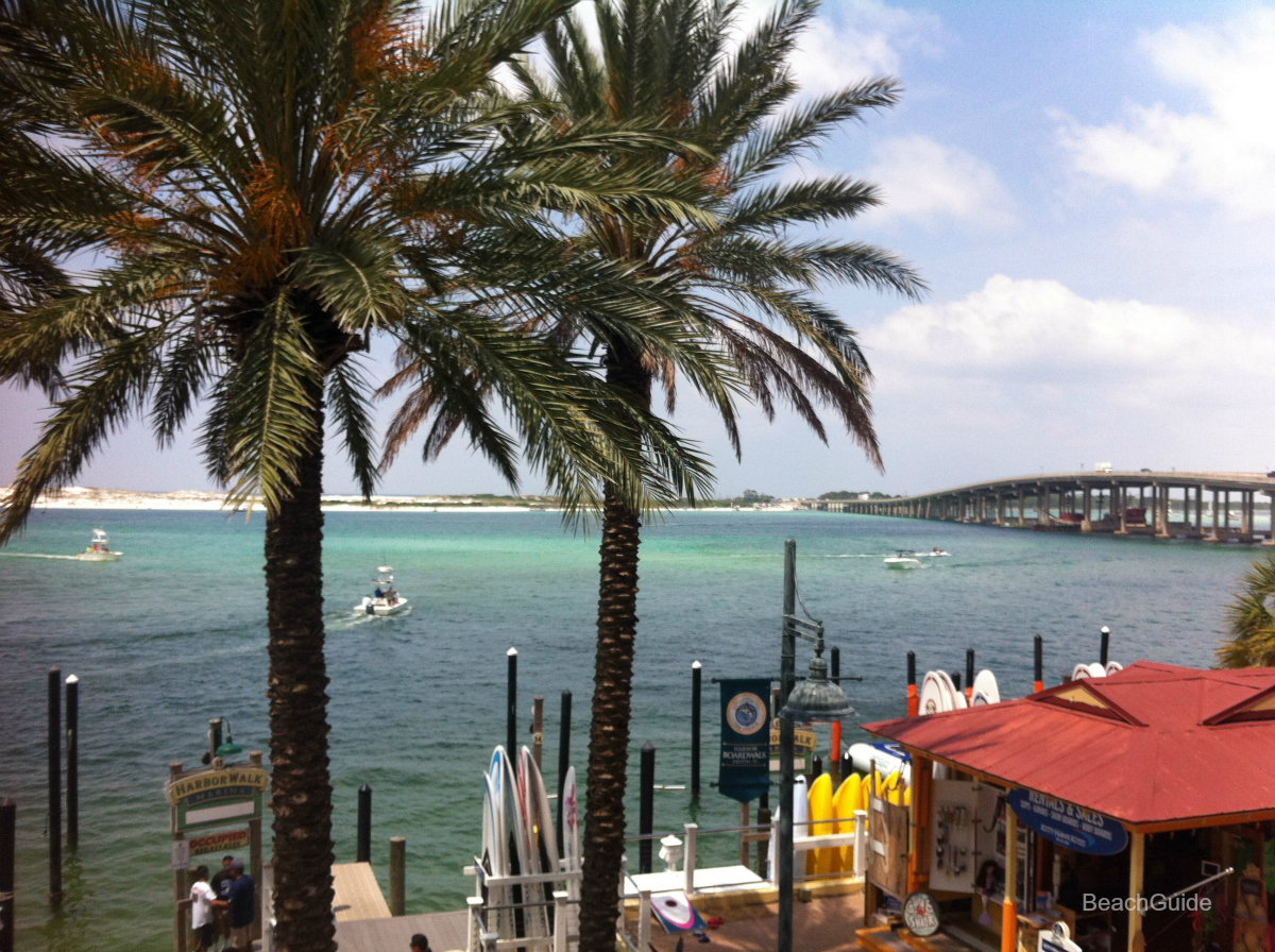 View of Destin bridge from Harborwalk Village, where many fishing and cuise boats depart.
