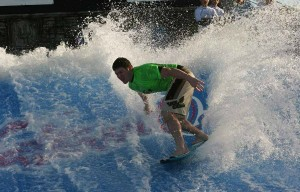 Teen surfing on the Flow Rider at Waterville in Gulf Shores