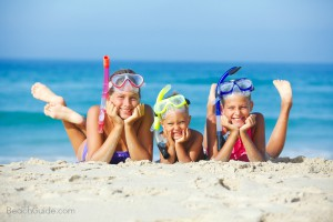 kids on the beach with snorkel and masks enjoying spring break