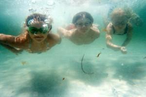 Kids snorkeling by the Destin jetties