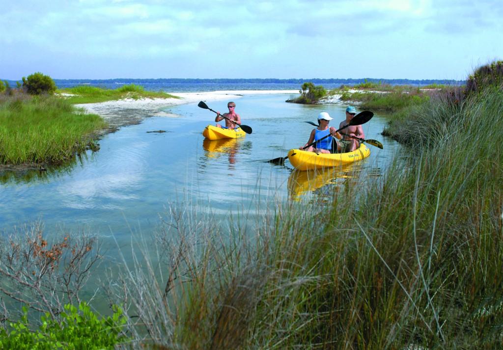 Tourists kayaking in Pensacola Beach Florida