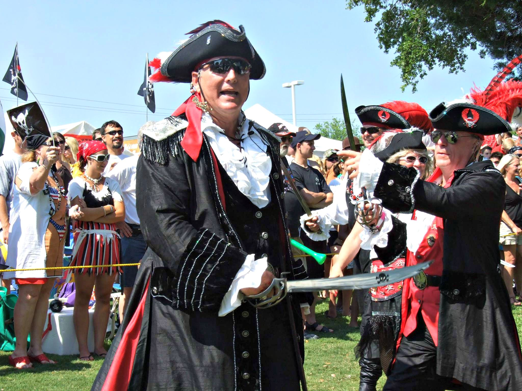 Two pirates skirmish with sword and knife in front of crowd at Billy Bowlegs Festival in Fort Walton