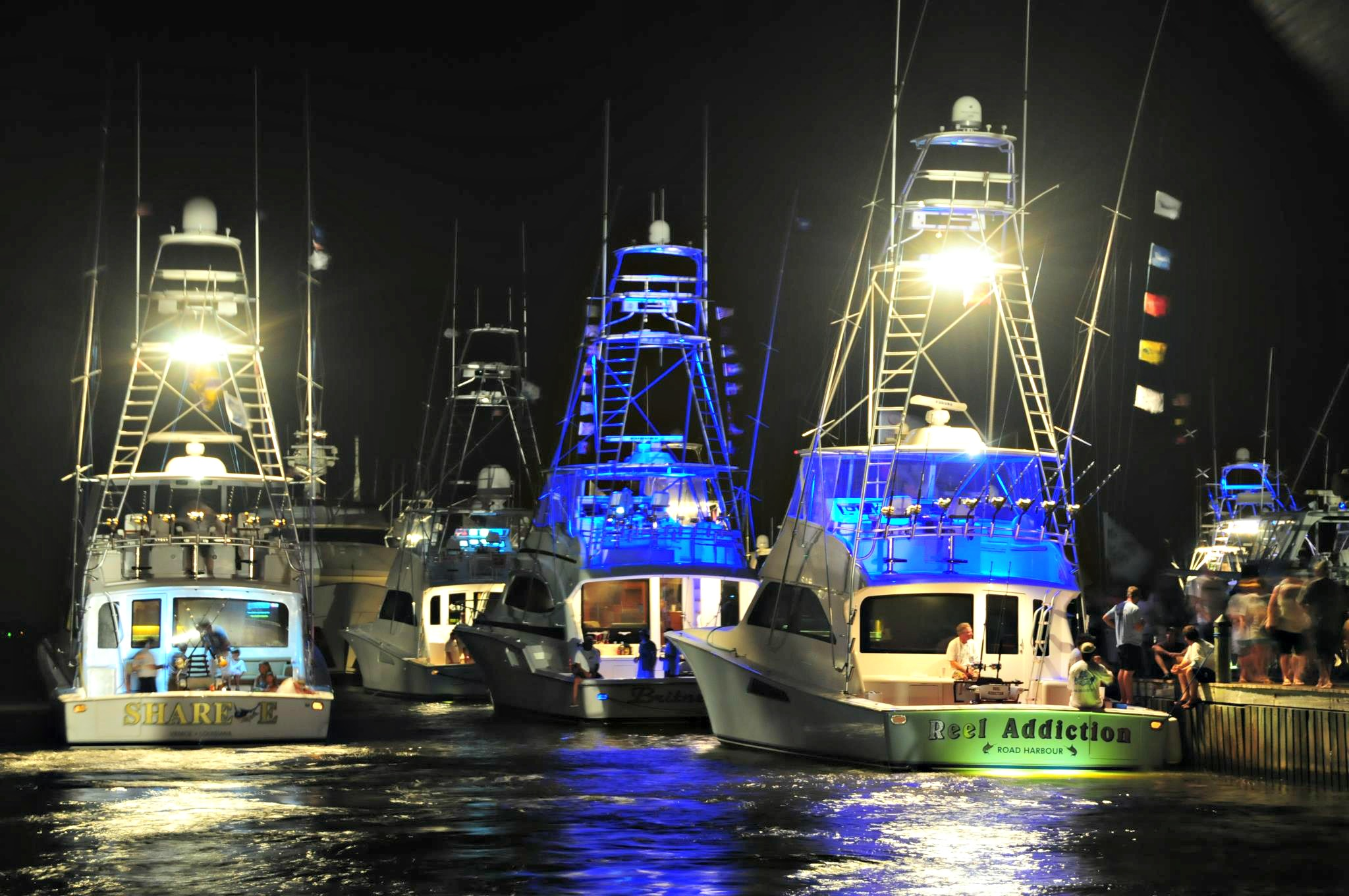Night view of fishing boats under way during the Emerald Coast Blue Marlin Classic at Sandestin