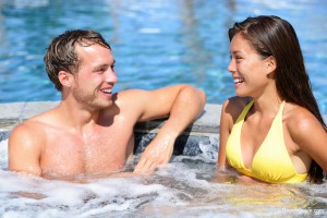 Couple enjoying a hot tub in mild Gulf Shores weather