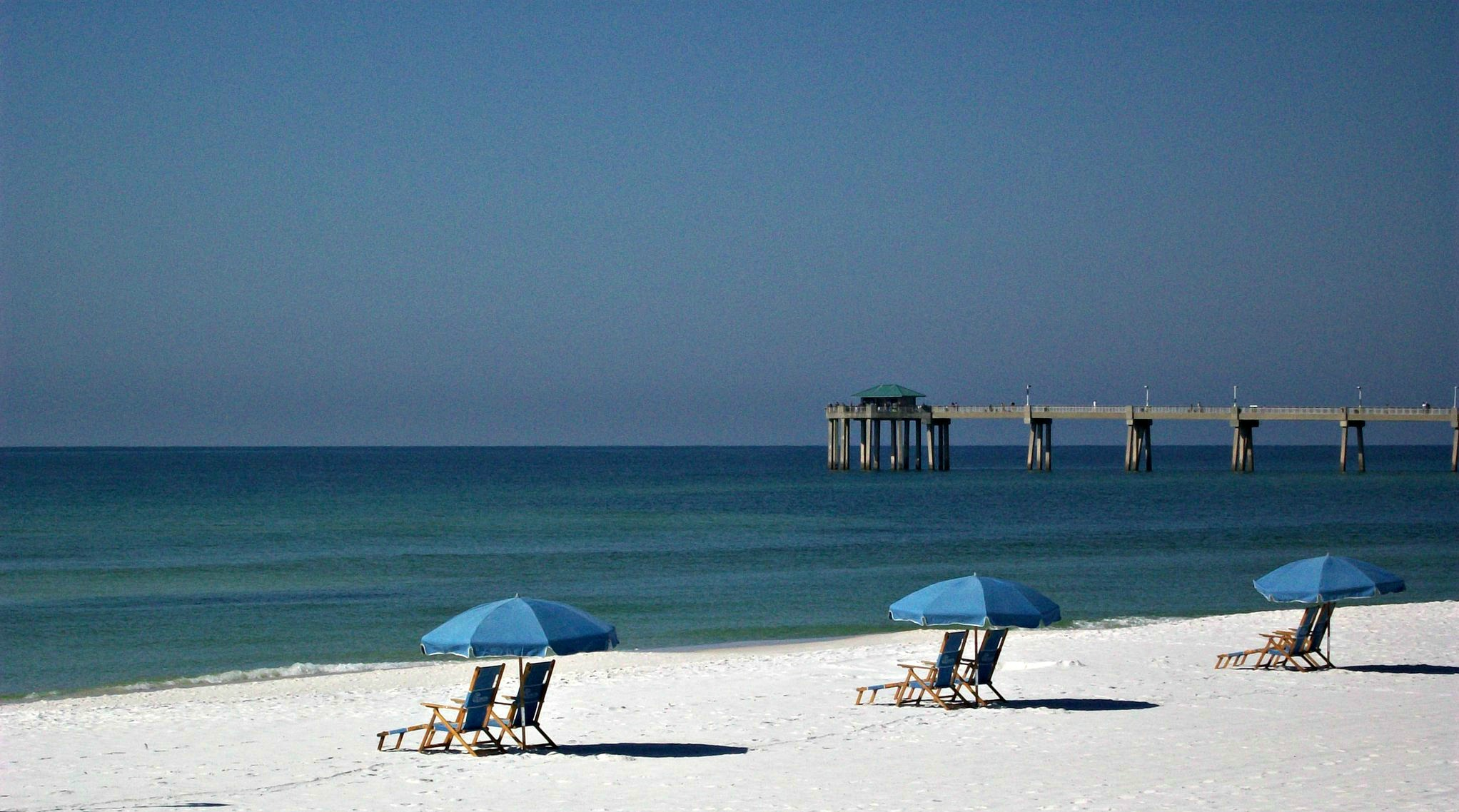 Beach umbrellas with a view of the Gulf at Seaspray Condominiums in Fort Walton Beach