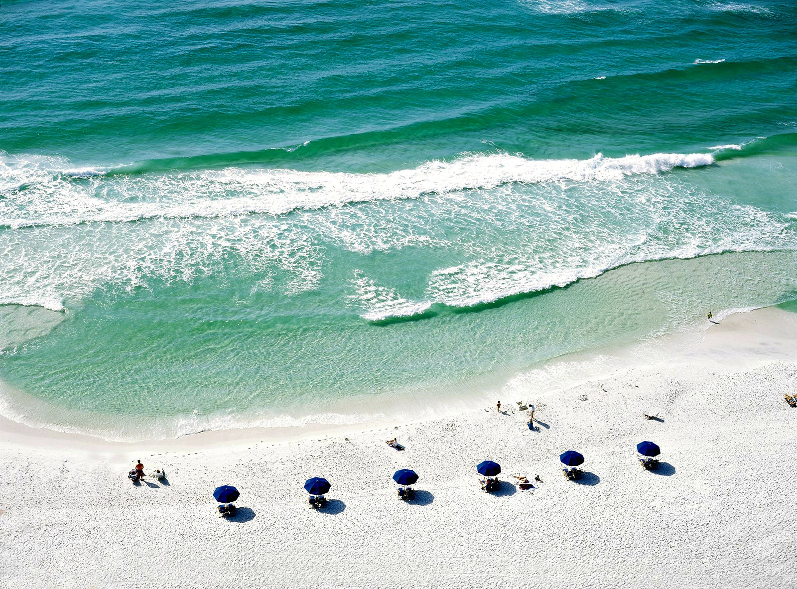 Gulf of Mexico and white-sand beach, plus blue beach umbrellas, at Sandestin Golf and Beach Resort