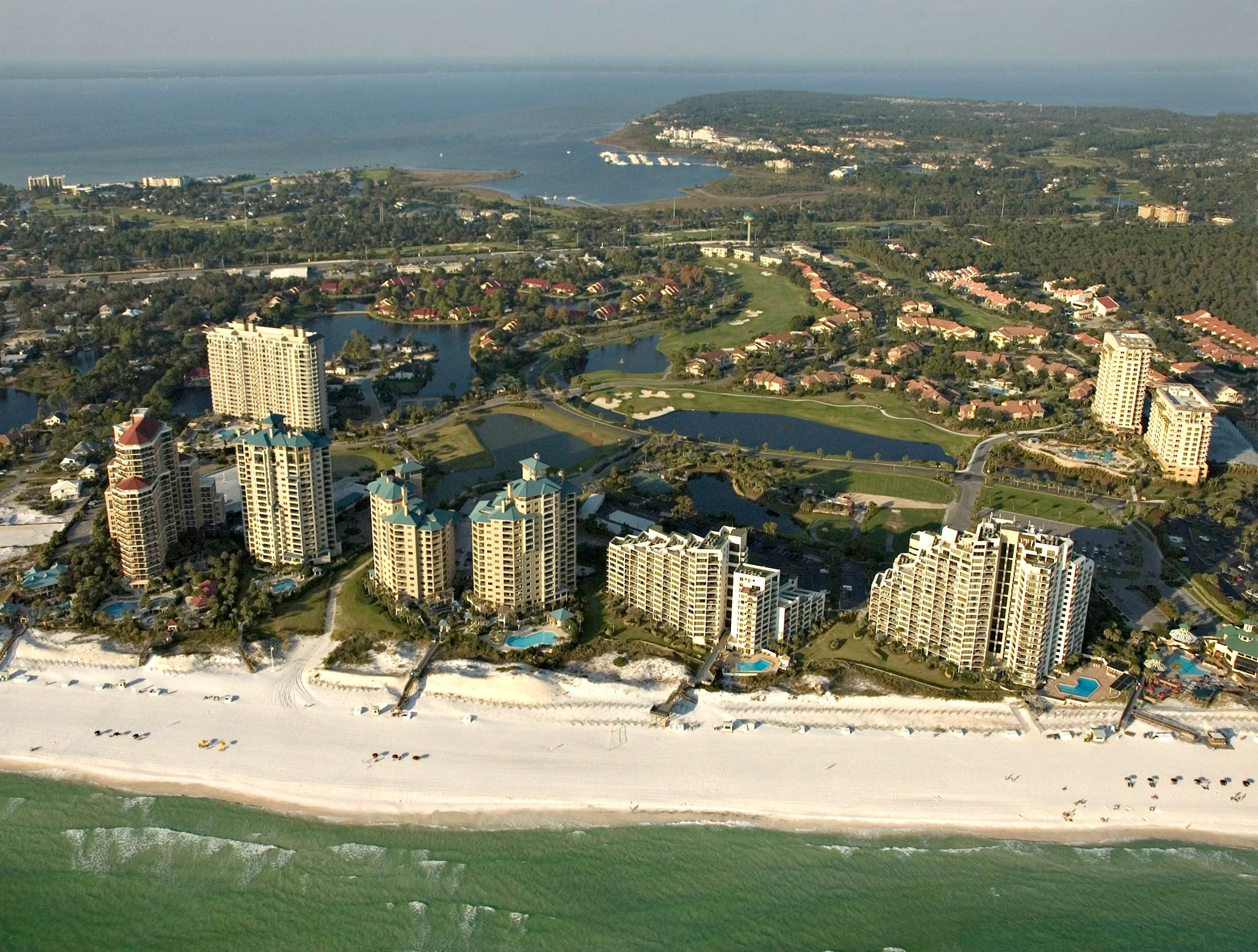 Aerial view of Sandestin Golf and Beach Resort, the Gulf, and the bay