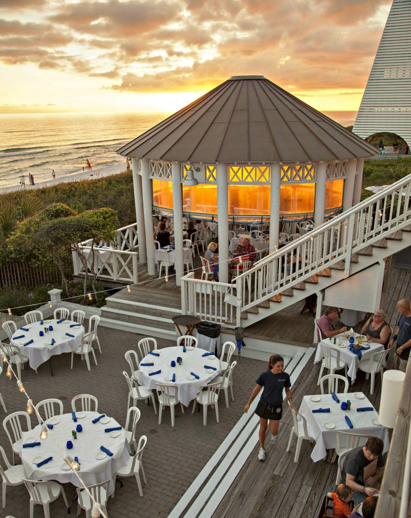 Sunset view of the columned gazebo, a few diners, and servers at Bud and Alley's in Seaside