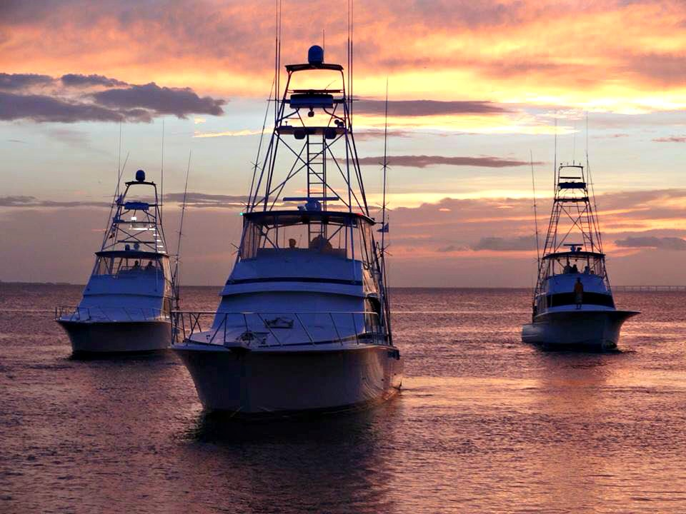 Three fishing boats at sunset during Destin Fishing Rodeo