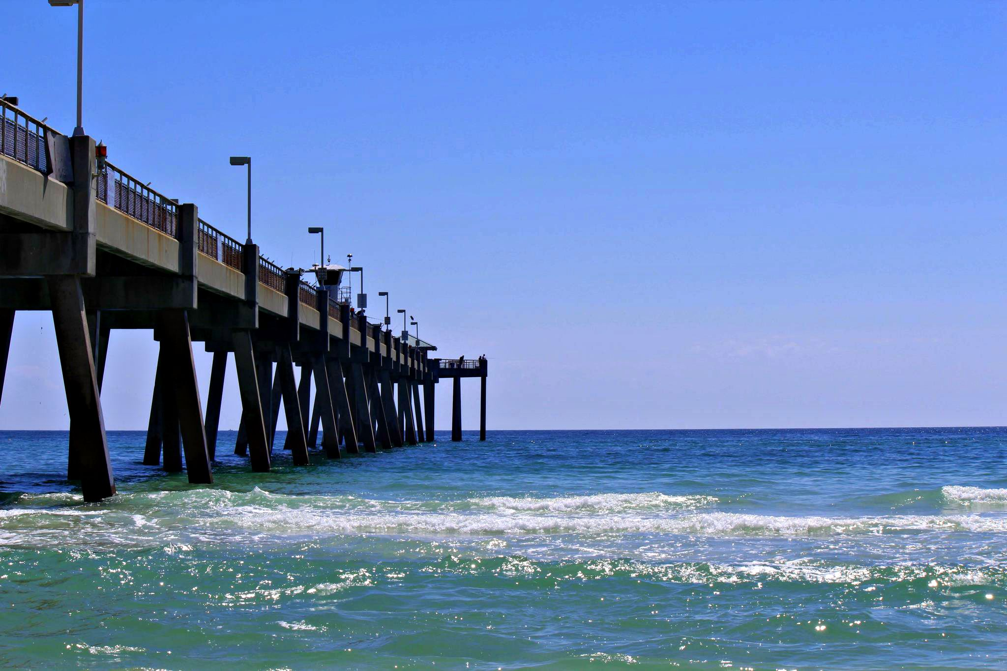 Gulf waves lapping against the Okaloosa Island Fishing Pier in Fort Walton Beach