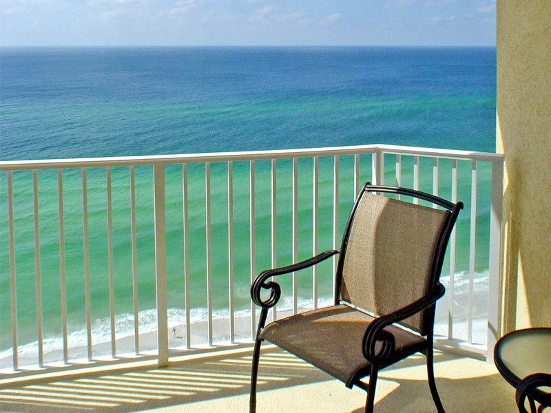 Boardwalk Beach Resort balcony with chair and view of the Gulf