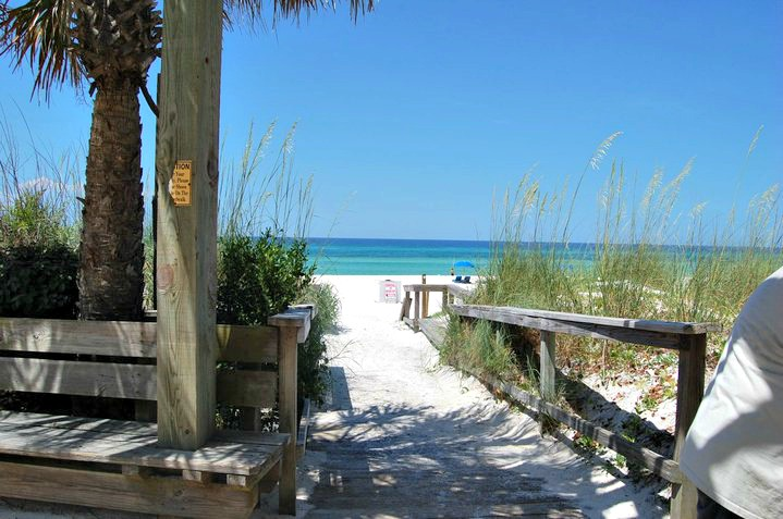 Boardwalk Beach Resort walkway over dunes and sea oats to beach and Gulf