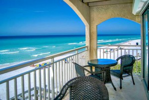 Sterling Resorts upscale balcony with wicker furniture and panoramic view of the beach and Gulf along Highway 30-A