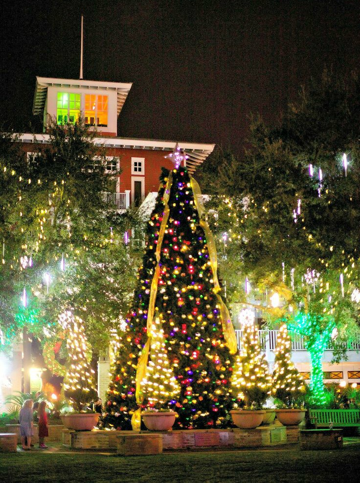 Decorated Christmas tree and holiday lights at Sandestin Golf and Beach Resort's Village of Baytowne Wharf for blog on holiday things to do in Destin and Fort Walton Beach
