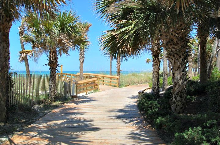 Palm-shaded path over the dunes at Boardwalk Beach Resort in Panama City Beach, Florida.