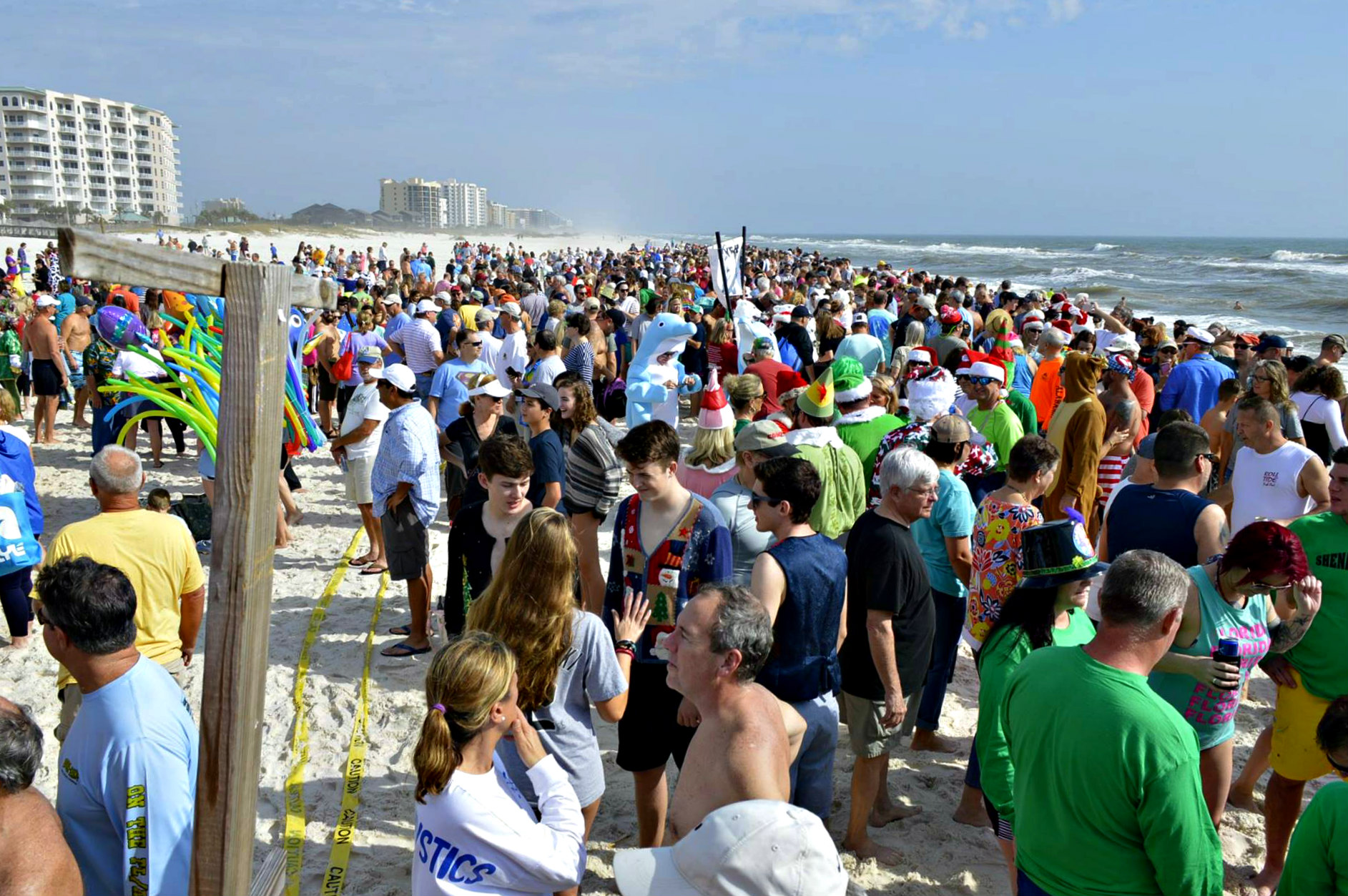 Flora-Bama Polar Bear Dip crowd taking chilly dip in the Gulf of Mexico