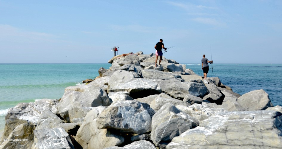 Fishing from rock jetty near Destin, Florida