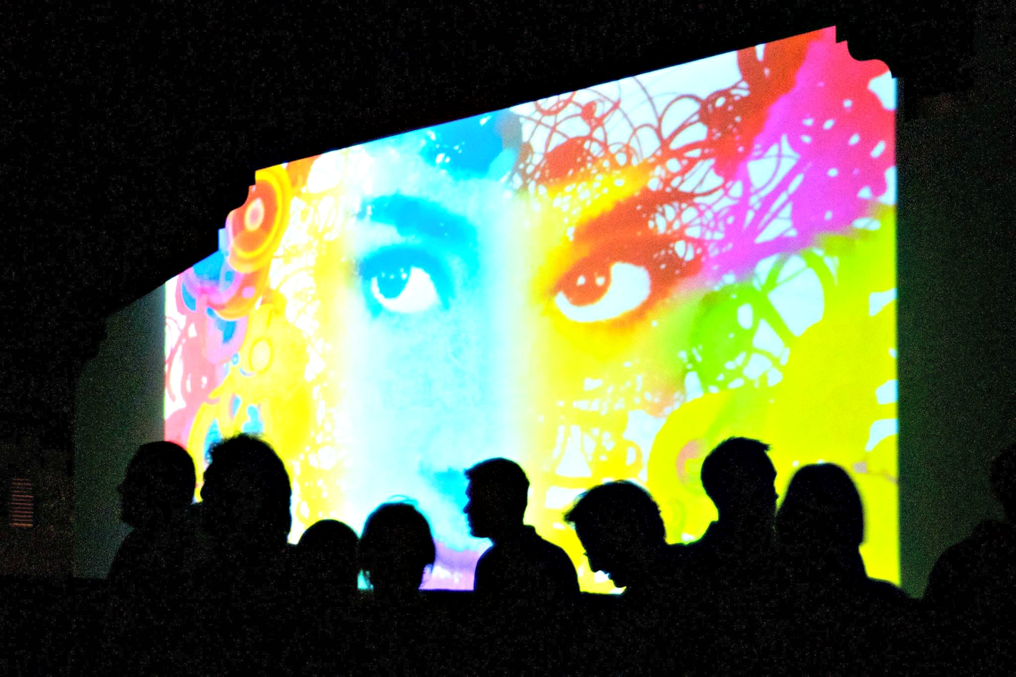 Digitally projected woman's face at Digital Graffiti in Alys Beach for Highway 30-A arts blog