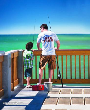 Father and son getting ready to fish from the pier in Panama City Beach