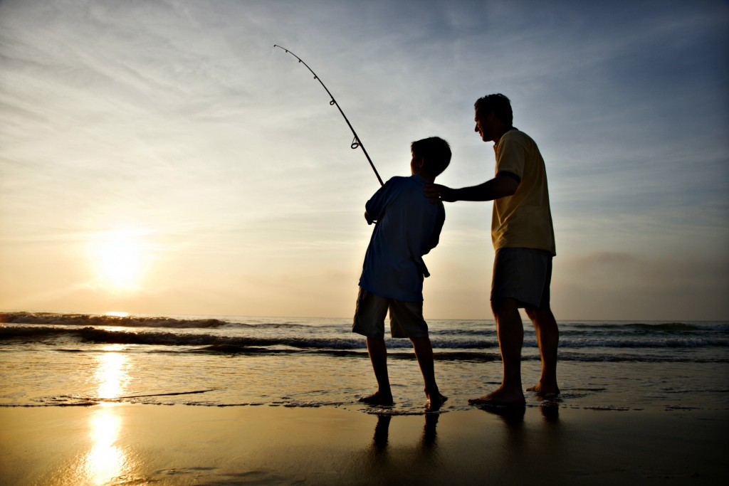 Father and son fishing from the beach for Gulf Coast fishing blog