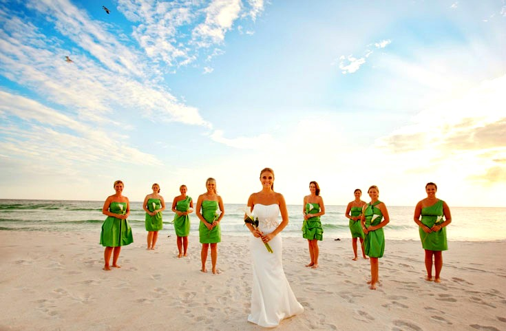 Bridal wedding party on the beach in front of Boardwalk Beach Resort