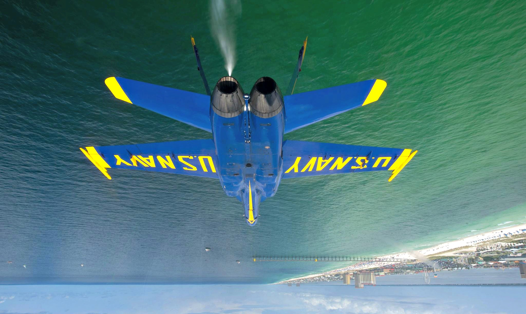 Blue Angels jet flying upside down over the Gulf of Mexico during a Blue Angels air show in Pensacola Beach