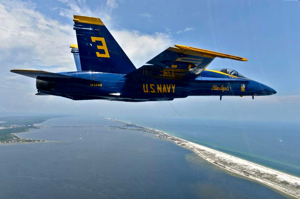 Blue Angels fighter jet flies over the Gulf of Mexico.