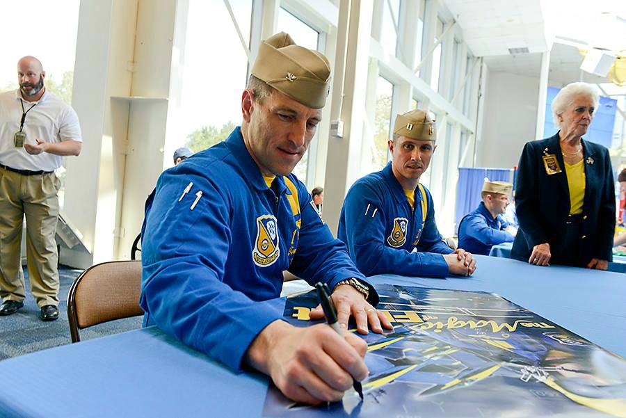 The Blue Angels sign autographs at Pensacola's National Naval Aviation Museum after their practice flights.