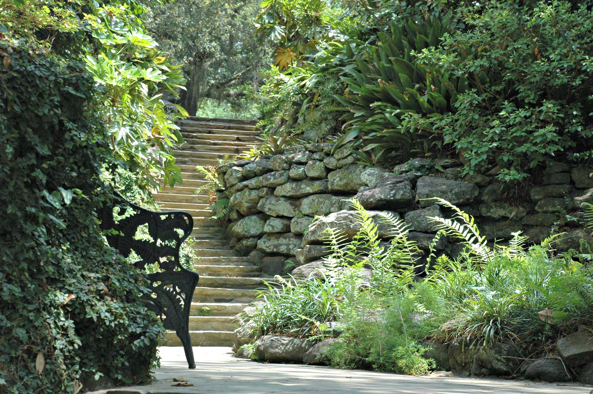 Ferns and other lush greenery flank a stairway at Bellingrath Gardens and Home, one of ten easy day trips from Gulf Shores