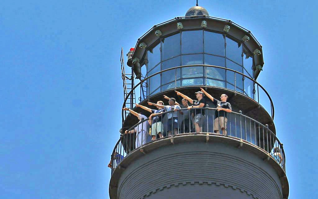 Visitors enjoy the view from the top of the Pensacola Lighthouse, one of ten easy day trips from Gulf Shores