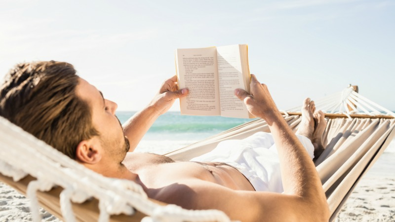 Reading in a hammock is a relaxing beach activity that requires little planning or money