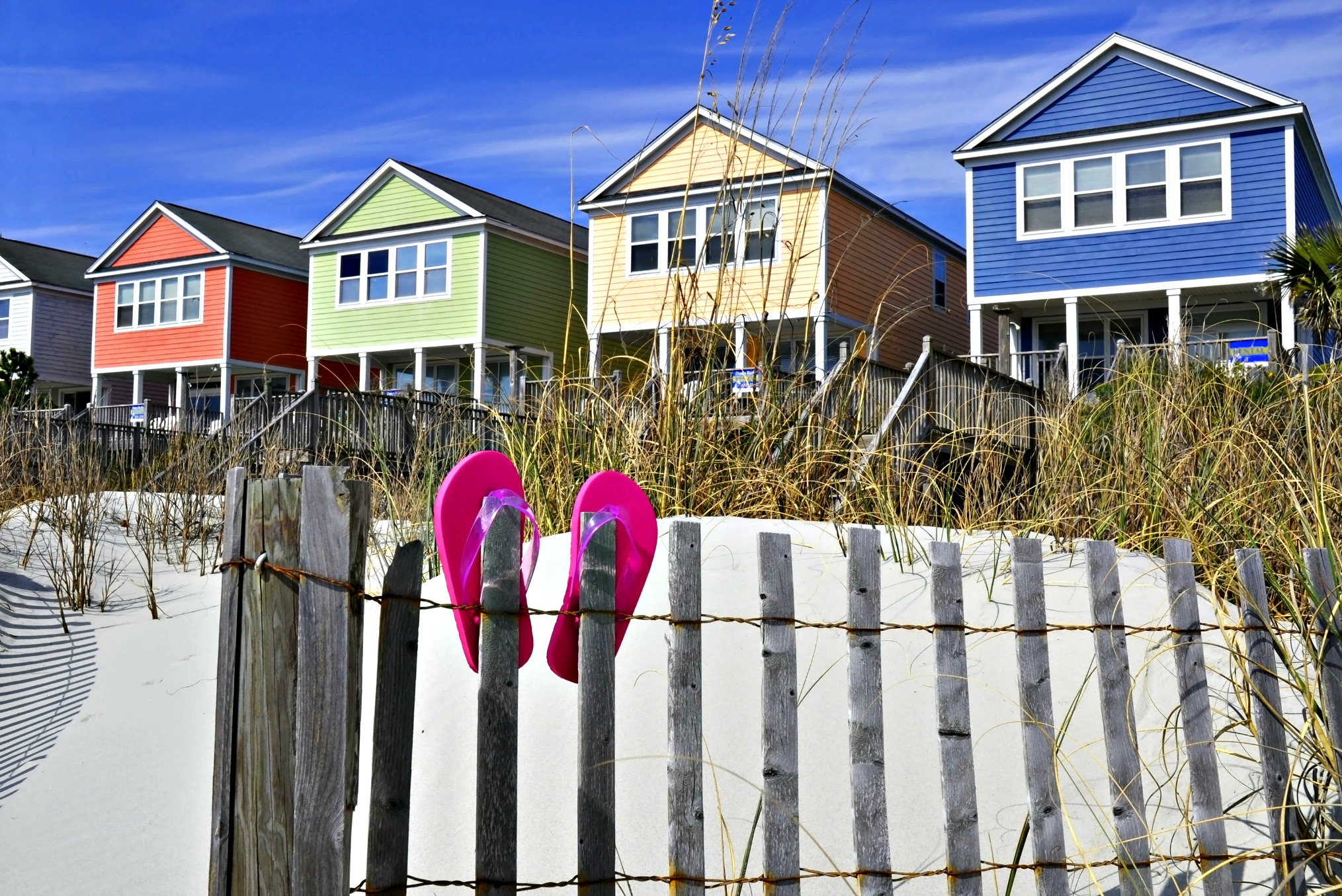 Row of colorful beach vacation rentals