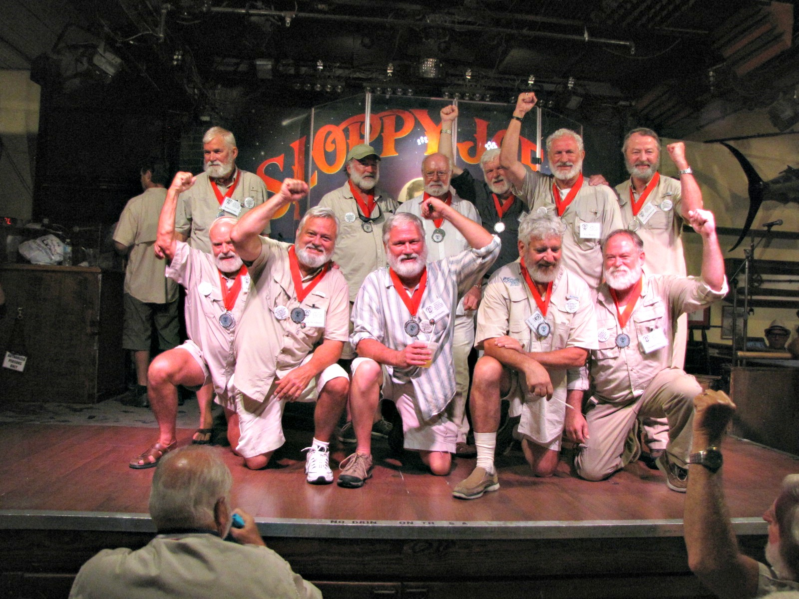 Hemingway look-alike contestants gathered on the stage at Sloppy Joe's Bar in Key West during Hemingway Days