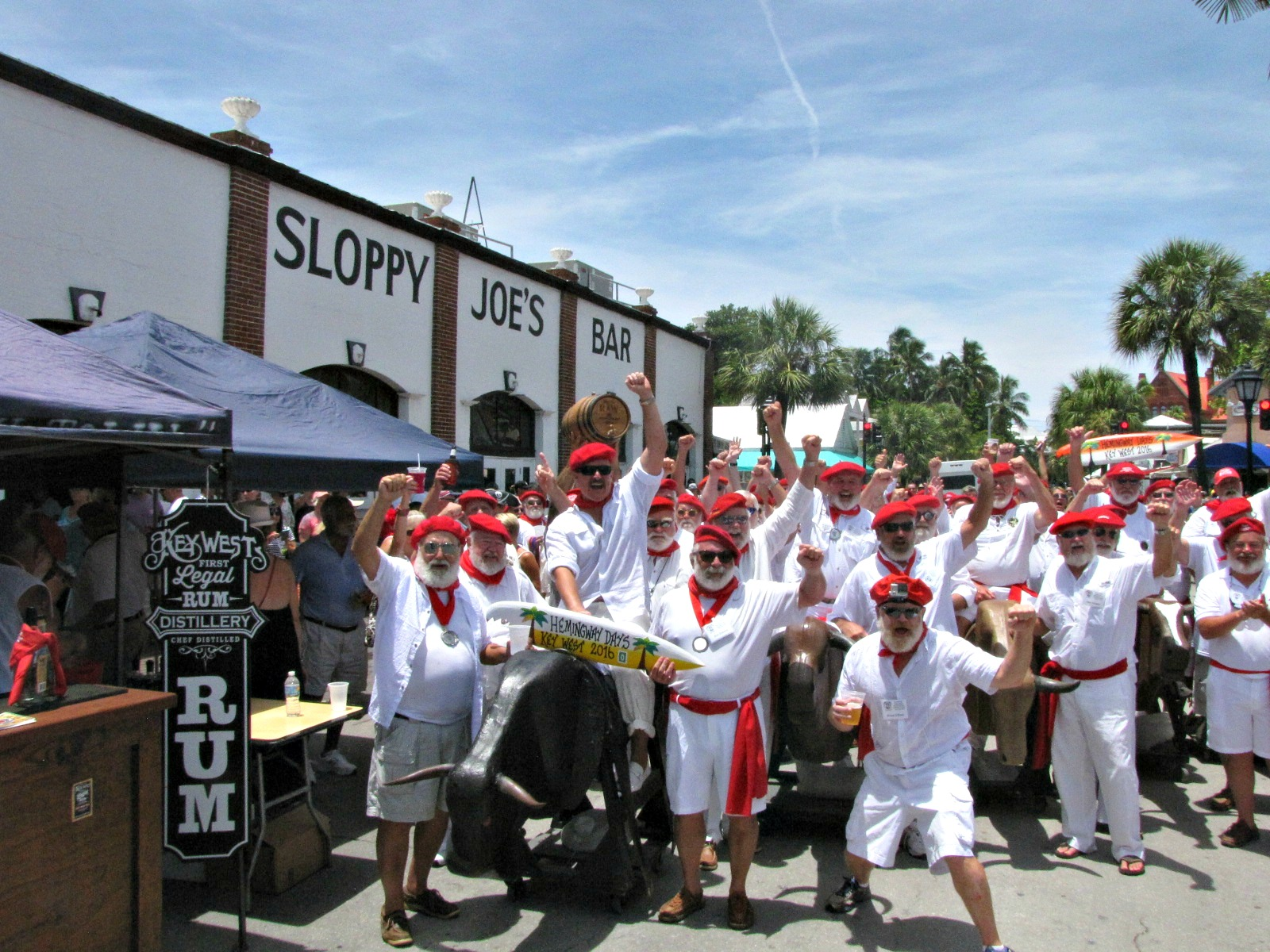 "Hemingway look-alikes run with the ""bulls"" outside Sloppy Joe's Bar in Key West during Hemingway Days; 2017 Hemingway Days is scheduled for mid-July."