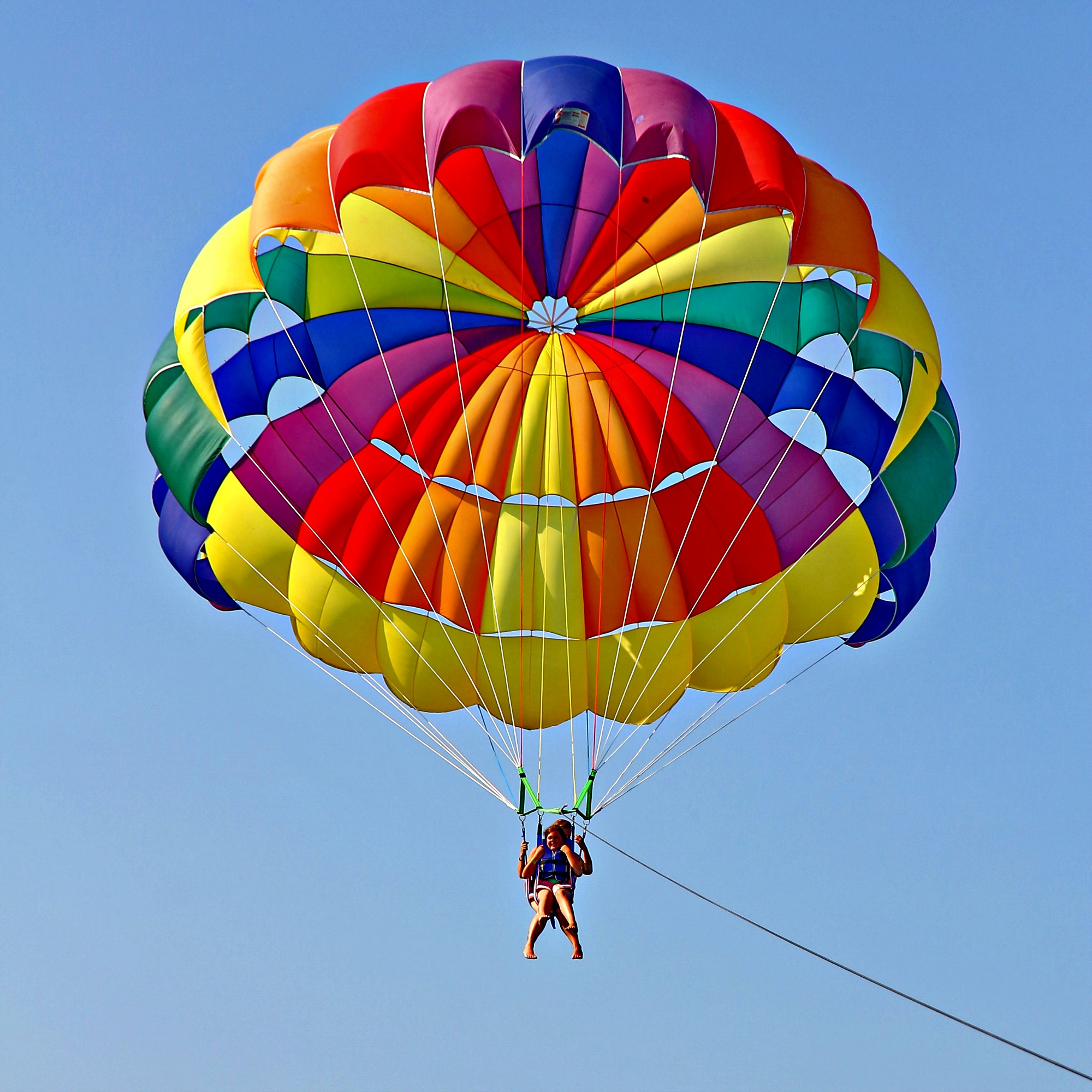 parasailers with multi-colored canopy