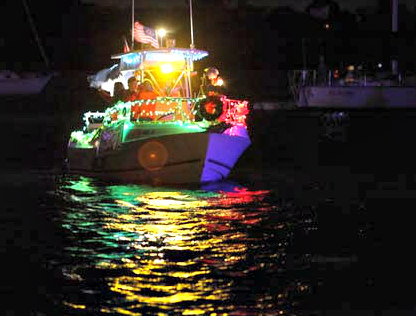 Holiday lights decorate a boat in the Venice Christmas Boat Parade.