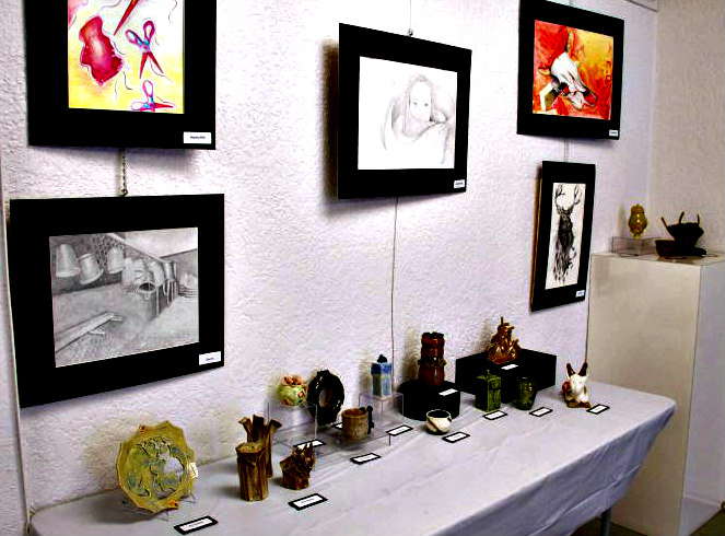 Anna Maria Art League tabletop and wall displays of paintings and pottery