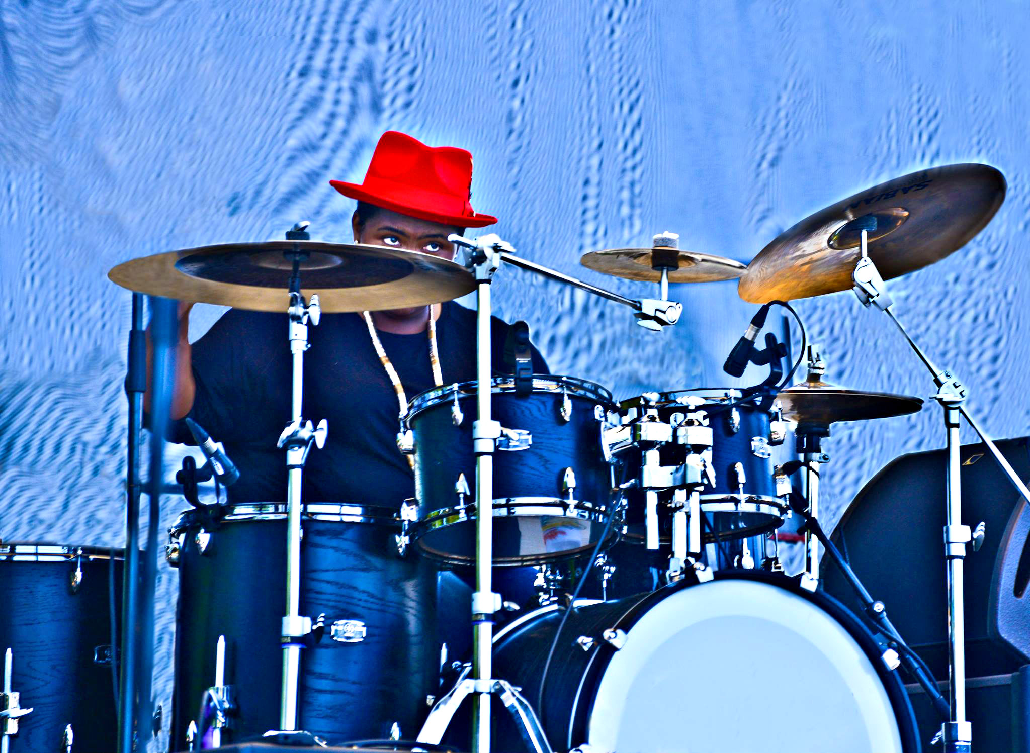 Drummer in red hat performs at Tampa Bay Blues Festival.