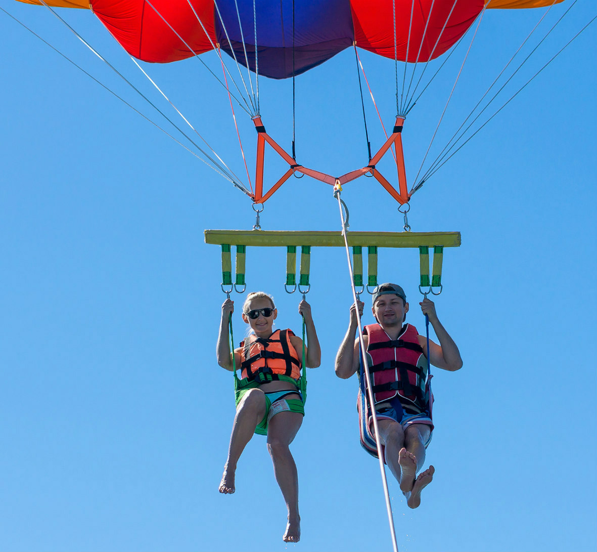 Young couple parasailing together