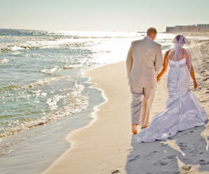 The private beach in front of the resort is the most popular wedding venue at Sandpiper Cove.