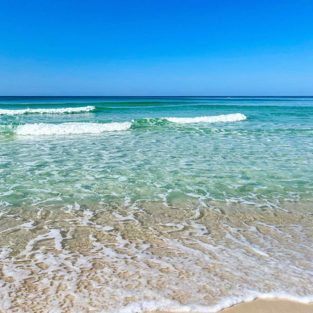 Beautiful soft white sand beach and clear turqoise water at Panama City Beach, Florida